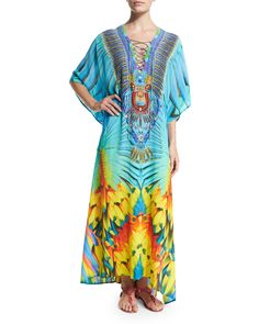 Camilla printed silk crepe kaftan. Lace-up plunging V neckline. Half cape sleeves. Relaxed fit. Asymmetric hem. Pullover style. Imported.