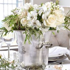 Take a silver wine container and fill it with all one color of florals...perfect centerpiece. #deborahlevydesigns #sharinginspirations #mondaymotivation #inspiringtables #tableinspiration #springtablescape