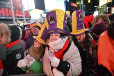 Crystal ball drops in frigid Times Square to mark 2018 - January 1, 2017.  People gather in Times Square during New Year's Eve celebrations, Sunday, Dec. 31, 2017, in New York. New Yorkers, celebrity entertainers and tourists from around the world are packing into a frigid Times Square Sunday to mark the start of 2018 with a glittering crystal ball drop, a burst of more than a ton of confetti and midnight fireworks. (AP Photo/Go Nakamura)