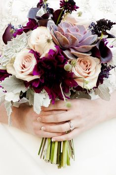 Fall wedding bouquet of roses, succulents and earthy accents.