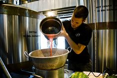 Isaac Ball prepares watermelon for Huske Hardware House's Watermelon Wheat, a Spring/Summer seasonal beer at the brewery.