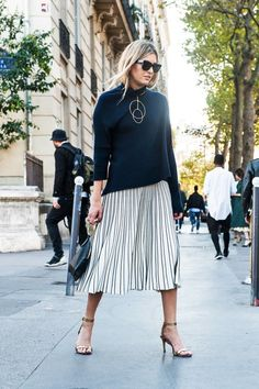 Street Style—Black sweater with metalic pleated skirt, gold accessories, minimalist ankle strap heel and black sunglasses