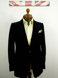 Black velvet evening / smoking jacket with peak lapels.