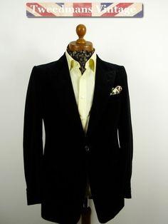 Black velvet evening / smoking jacket with peak lapels.
