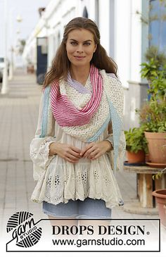 Free pattern Knitted shawl with lace pattern and garter stitch in stripes. The piece is worked in DROPS Alpaca.