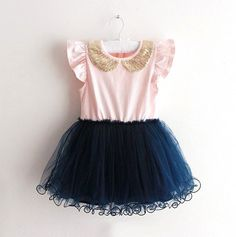 This adorable dress features a pink top, navy tutu bottom and gold sequined collar.