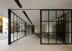 Gridded glass rooms added to a Melbourne residence.