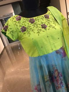 Beautiful parrot green and ice blue color combination floor length dress with floral design hand embroidery thread work on yoke. Ready to ship Price : 8500 INRTo order whatsapp 7013728388 25 September 2018 Long Dress Design, Dress Neck Designs, Bridal Blouse Designs, Hand Work Blouse Design, Stylish Blouse Design, Party Wear Maxi Dresses, Anarkali Dress, Punjabi Dress, Ikkat Dresses