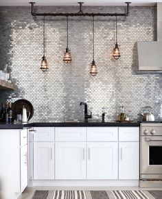Wallpaper might be making a major comeback, but if you're looking for a slightly more permanent and incredibly sophisticated way to upgrade your digs, tile is the way to go. It's super versatile an...