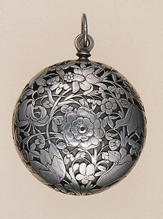 1660-1670 French Silver watch with alarm at the Metropolitan Museum of Art, New York - What is shown here is the silver case; click the pin to see what it looks like on the inside.
