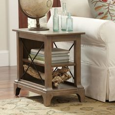 Kenmore Chairside Table | Warm and weathered, this chairside table is carefully crafted with hardwood solids and oak veneers for long-lasting durability. Two levels of shelving are enclosed with metal X-supports that maintain an open look.