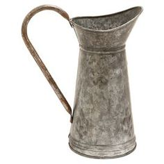 """Galvanized metal jug.   Product: JugConstruction Material: Galvanized metalColor: Distressed silverFeatures:  Resistant to wear and corrosionSuitable for indoor and outdoor use Dimensions: 16"""" H x 10"""" W x 8"""" D"""