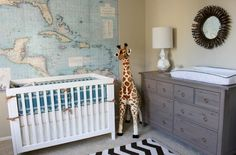 Adorable baby boy's nursery design with map, white modern crib, zigzag rug, Ikea Hemnes Dresser in Gray-Brown used as changing table and giraffe. Travel Theme Nursery, Nursery Themes, Nursery Room, Nursery Decor, Nursery Ideas, Map Nursery, Nursery Grey, Giraffe Nursery, Themed Nursery