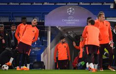 Lionel Messi of Barcelona walks out to the pitch during of an FC Barcelona Training Session ahead of there Champions League last 16 match against Chelsea at Stamford Bridge on February 19, 2018 in London, England.