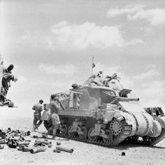 A Grant tank crew loading up with ammunition from a truck, June 1942