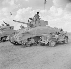 Jeep and Sherman tank in the desert