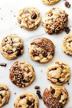 Jan 25, 2021 - Delicious toffee and pecan stuffed chocolate-chip cookies dipped in melted milk chocolate. These toffee pecan cookies are soft & chewy with crisp edges! Chocolate Chip Shortbread Cookies, Toffee Cookies, Chocolate Cookie Recipes, Easy Cookie Recipes, Yummy Cookies, Sweet Recipes, Cookies Soft, Brownie Cookies, Fudge Recipes