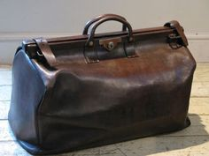 60bd9c4e4b7 Briefcases / Suitcases - An early century English, leather gladstone bag.