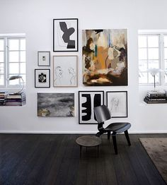 Modern gallery wall. A mix of black an white design with pops of color.