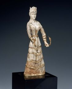 Minoan statue of the Snake Goddess. Shows the early thoughts of Wasp-Waisted women and men.