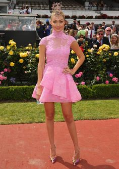 Gigi Hadid.. Alex Perry candy-pink dress, with Jonathan Howard headpiece..