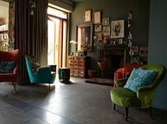 green chairs in living room / dark walls