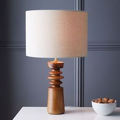"""The shapely profile of our Turned Wood Table Lamp brings in an element of classic, sophisticated style to any nightstand, console or desktop. 14""""diam. x 23""""h..."""