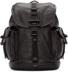 Buffed leather backpack in black. Carry handle at top. Adjustable padded shoulder straps. Foldover flap featuring signature hardware at press-release fastenings. Drawstring fastening at throat. Zip closures at back face. Zippered pocket at interior. Tonal textile lining. Matte black hardware. Tonal stitching. Approx. 12