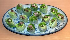 Summer rolls with duck and avocado, served as sushi.