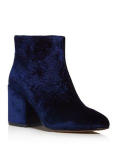 Velvet takes opulent yet subversive form in French Connection's mod-style booties, stamped with exotic croc texture. | Croc-embossed velvet upper, synthetic lining, synthetic sole | Imported | Fits tr