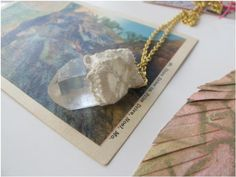 """""""Vintage lace and doilies find new life when cut up and glued onto the tops of quartz crystals. That way we can wear pretty rocks without having to drill holes in them! Simply cut a strip of lace or doily and use a glue gun or regular Elmer's to attach it to the top of a pendant. A little jump ring or piece of wire run through the holes makes it ready to hang from a piece of leather cord, or a chain.""""    http://blog.freepeople.com/diy/#ixzz2Kug2jwIs  Free People Blog 