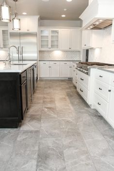 grey flooring Muted Grey Tile Floor Kitchen and White Tile Kitchen Backsplash Kitchen Cabinets Grey And White, Grey Kitchen Tiles, Grey Floor Tiles, Kitchen Tiles Design, Grey Flooring, Kitchen Flooring, Kitchen Backsplash, Kitchen With Tile Floor, White Tiles Grey Grout