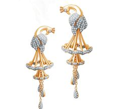 Gold and diamond peacock earrings.