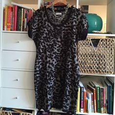 Calvin Klein Leopard-Print Minidress Adorable short-sleeved mini sweater dress--soft but lightweight knit, looks amazing with leggings or tights and a big necklace for a night out! Calvin Klein Dresses Mini