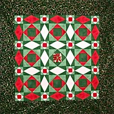 Christmas at Sea quilt, made by Cathy K of Maryland. Cathy added a poinsettia in the center square. Pattern from the Simply Sensational 9-Patch Stars book by Carol Doak.