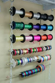 Inexpensive Ribbon Holder - simple chain, s hooks and cafe curtain rods. It don't get no better. Sweet IDEA!