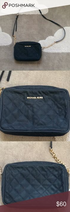 "Michael Kors crossbody Navy quilted fabric crossbody bag. Some stains on bag but barely noticeable (as seen in pictures), can probably come out with a spot clean. Some wear on one section of strap, as shown in pictures. Inside of bag good as new. No tears. 9""x6"", 2"" wide. Michael Kors Bags Crossbody Bags"