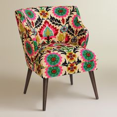 Boasting a mid-century-modern-inspired silhouette, our plush, custom-made accent chair is handcrafted in the U.S.A. of solid pine with bright floral-patterned cotton upholstery.