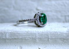 Beautiful Vintage 14K White Gold Diamond and Emerlad Halo Ring - 1.43ct.. via Etsy. Dreamy.