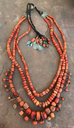 Faouzi Designs | Three strands of antique undyed Mediterranean coral beads found in Morocco, some of which were wired as hair beads. A unique adjustable closure with very old Moroccan coins, which allows the necklace to go over your head without a clasp | 6'500$