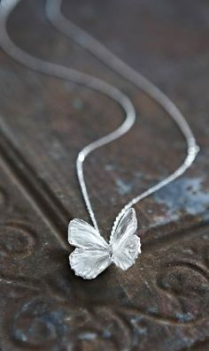 """Quinn pulled a silver chain out of his pocket, and on it hung a silver winged butterfly, as lovely as a crystal. I gasped. """"It's so beautiful..."""" He came behind me and clasped it around my neck. It was cold to the touch and gave me a chill. But it was a good chill. """"For us to remember her by."""" - Flutterbye"""
