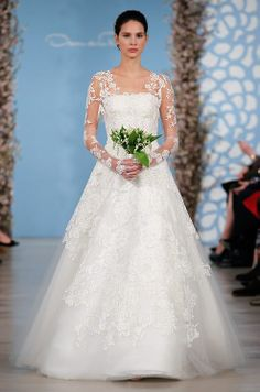 Oscar De La Renta, Long-sleeved lace wedding gown.  I love the sleeves and that the lace overlay is cut out.