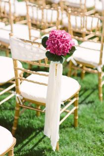 Gold Chiavari chair with floral bunch attached