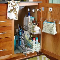 Problem Spot: Vanity Cabinets: Never lose a bottle or hairbrush to the back of your bathroom cabinet again! Install a pullout shelf to keep everything visible.