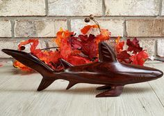 A beautifully hand-carved ironwood shark. Larger than most of the others I have seen! Quality workmanship went into this piece. Carved Wooden Animals, Princess House Crystal, Ocean Life, Old Things, Things To Sell, Shark, Hand Carved, Vintage Items, Coastal