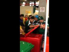 Mexican football fans stealing beer from a stall.  Watch in full at: http://ihatethisbecause.com