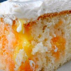 ORANGE DREAM CAKE Recipe - 1 box orange cake mix (Duncan Hines has a delicious boxed cake mix) bake then poke holes in the top,  mix 1 small box orange Jell-O Gelatin 1 c. hot water refrigerate FROSTING 1 small box instant vanilla pudding 1 c. milk 1 tsp. vanilla ½ tsp. orange extract 1 tub Cool Whip, thawed, or whipped cream