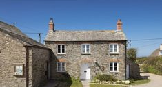 Luxury holiday cottage near Padstow with sea views, private hot tub and attractive garden Places To Visit Uk, Luxury Holiday Cottages, Gems, Cabin, House Styles, Destinations, Holidays, Home Decor, Holidays Events