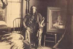 Chief Quanah Parker here with his most prized possession, a picture of his Mother Cynthia Parker