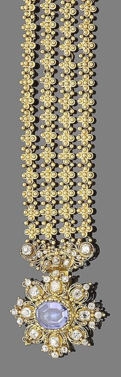 A gold cannetille, sapphire and diamond bracelet, circa 1820  Composed of four rows of beaded quatrefoil, terminating in cannetille work of scrolling design set with cushion-shaped and old brilliant-cut diamonds, to a fancy oval-cut sapphire in collet-setting within a similarly-cut diamond surround, diamonds approx. 2.75cts total, one diamond deficient, tongue deficient, length 17.2cm, fitted case